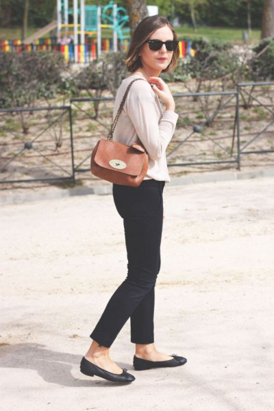 ivory cardigan with black crop jeans and brown small shoulder bag
