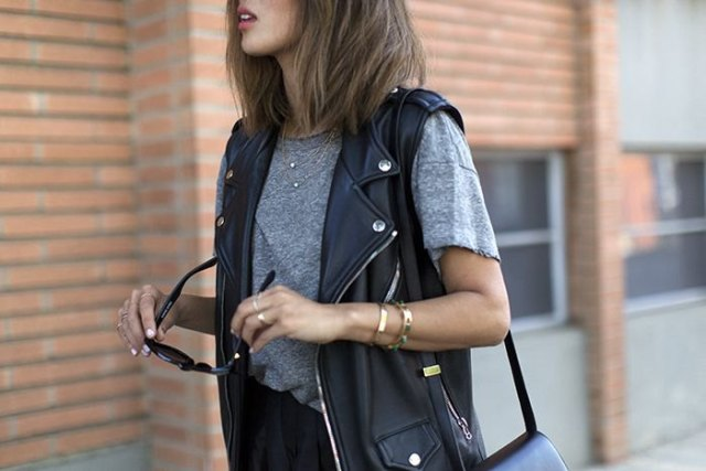 Heather gray tee with black biker leather vest