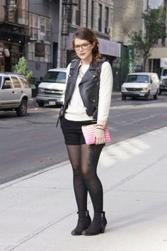 leather bicycle vest with white sweater and black mini skirt