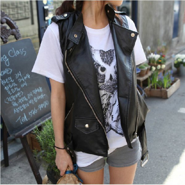 black biker vest with white print tee and gray mini shorts