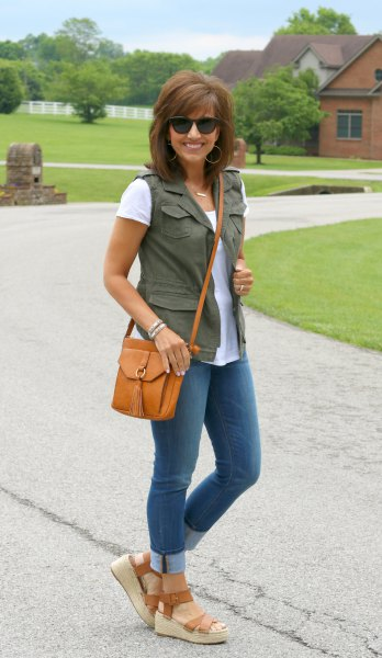 olive green vest with white tee and cuffed skinny jeans