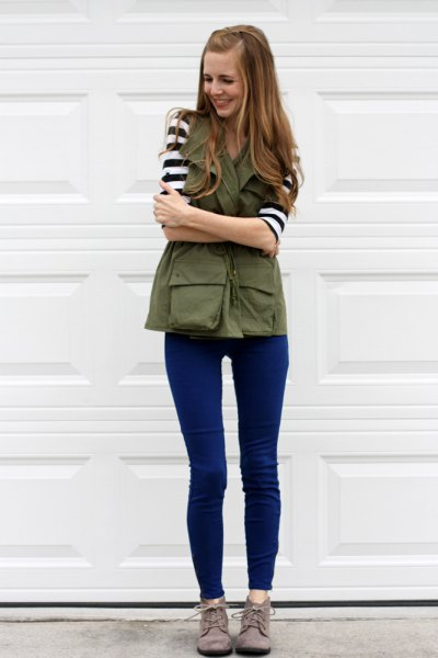 black and white striped t-shirt with olive vest and blue skinny jeans