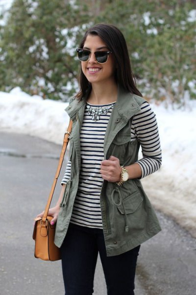 striped long sleeve tee with silver necklace and work vest