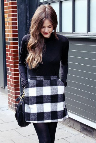 black long sleeve fitted tee with gray and white plaid wool mini skirt with pockets