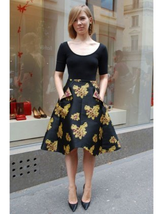 black neckline of shoe neck shape and matching top with floral printed knee length skater skirt