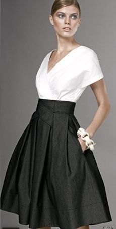 white v-neck wrap blouse with black waist flared skirt with high waist with pockets