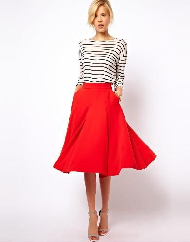 black and white striped long-sleeved tee with red midi-extended skirt
