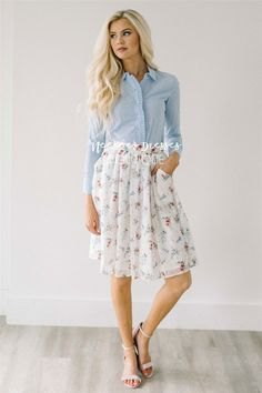 light blue shirt with white floral printed pleated chiffon skirt with pockets