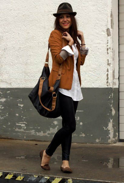 brown blazer with white oversized button up shirt and black floppy hat