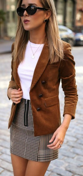 brown suede blazer with white fitted top and checkered mini skirt