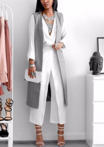 white wide legged trousers with gray long-line vest