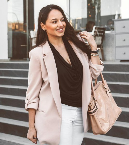 light gray khaki blazer with black neck and white jeans