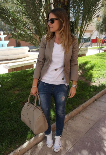 olive khaki blazer with white sweater and blue jeans