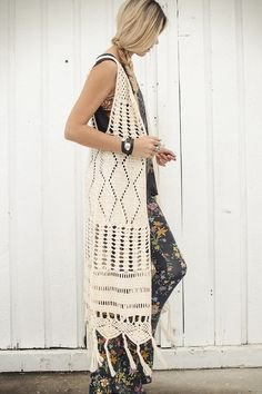 white crochet maxi length knitted hippie vest with floral printed leggings