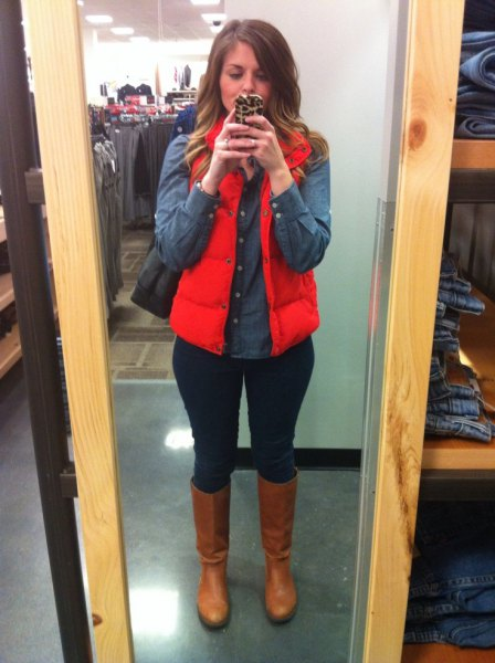 red puffer vest with dark blue chambray button