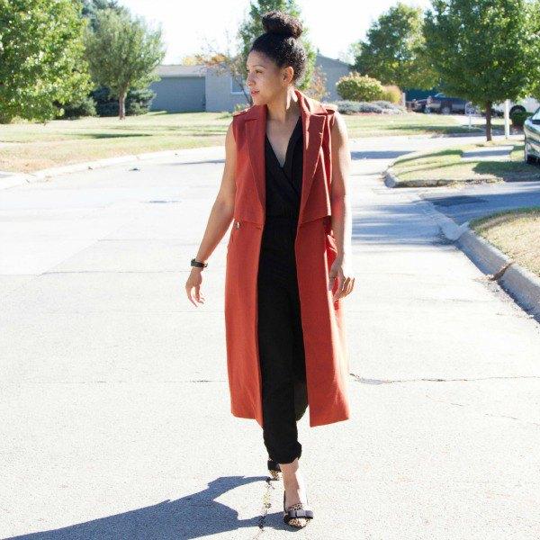 red sleeveless longline blazer like vest with black pieces