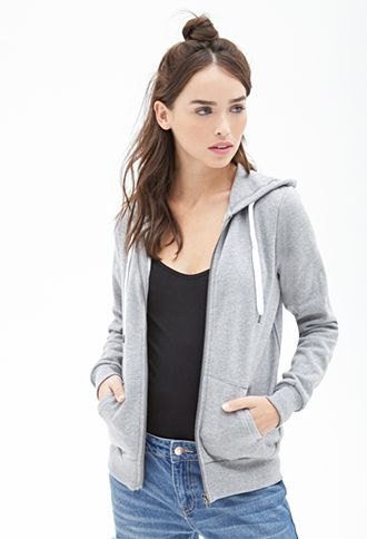 gray hooded jacket with a black shirt on the neck and slim jeans