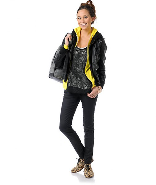 black leather jacket with lemon yellow hoodie and top with shoe neck