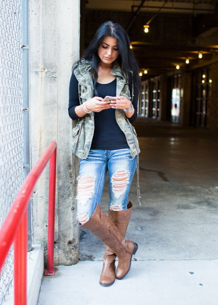 hooded military vest with black tee and ripped boyfriends