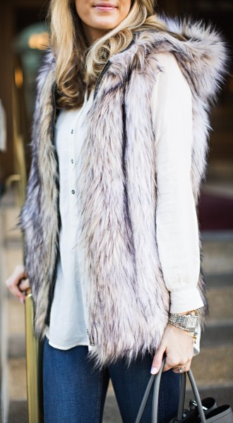 gray hood vest in fur in fur with white button-down blouse and skinny jeans