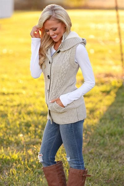 Ivory cable knitted head vest with black long sleeve tee and boots