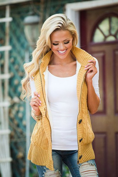 mustard yellow knitted hooded vest with white top mount