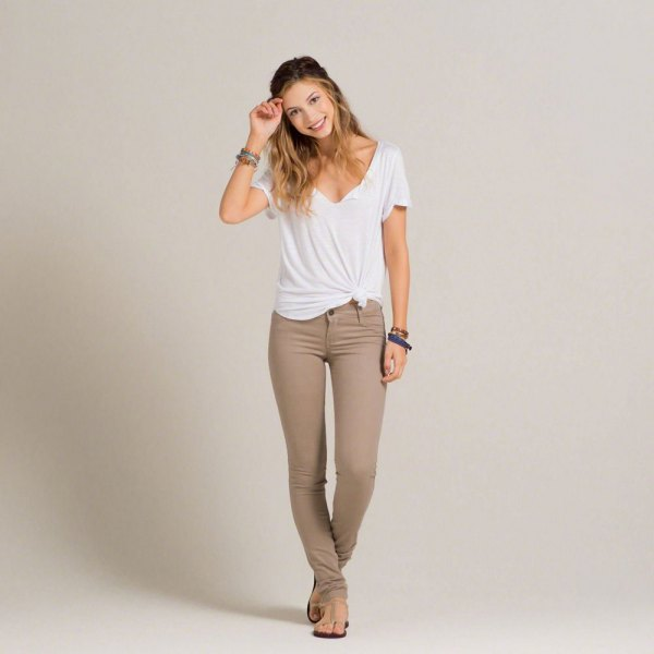 white v-neck knotted tee with gray-green super skinny jeans