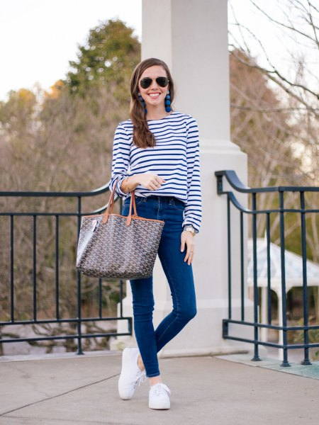 navy and white striped long sleeve tee with skinny jeans