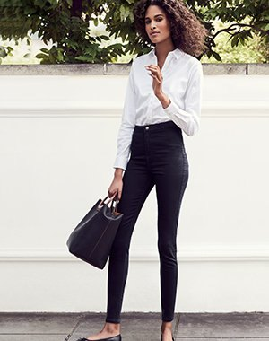 white button up shirt with black high skinny jeans with high rise