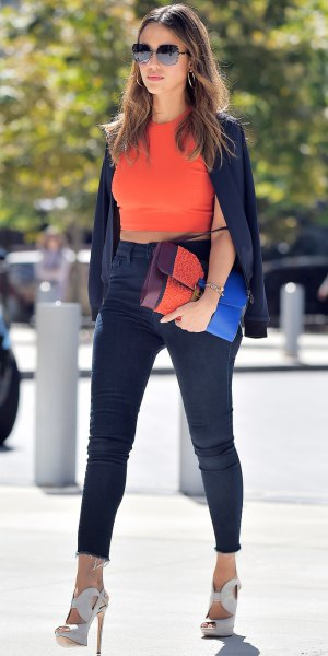 orange sleeveless crop top with black high heels with super high jeans