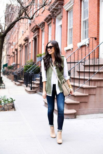white chiffon blouse with olive green vest and light pink shoulder bag