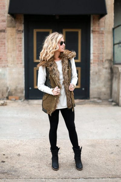 white sweater with crew neck with faux fur olive green military vest
