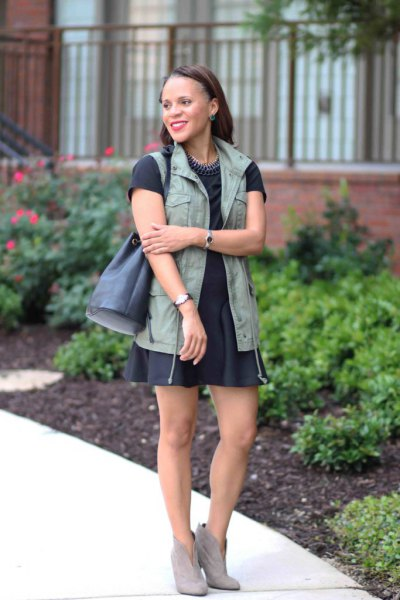 black short sleeve tee with matching skater skirt and military vest