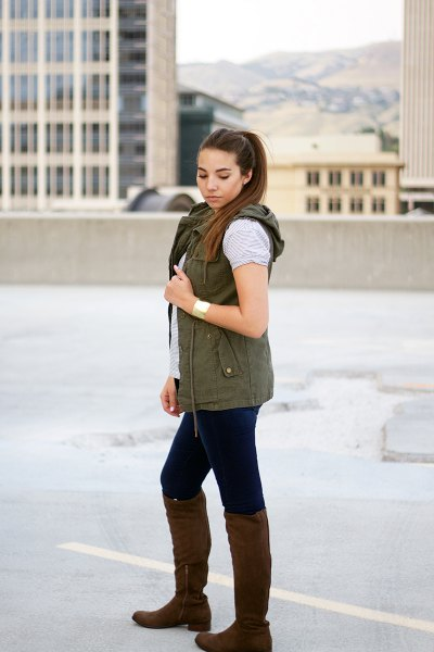 head vest with gray t-shirt and knee-high boots