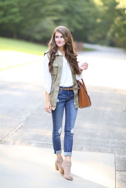 white blouse with light brown vest and gray suede suede boots