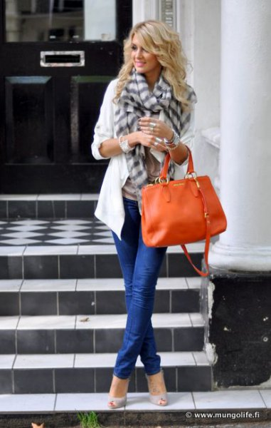 white casual blazer with gray checkered scarf and orange leather case
