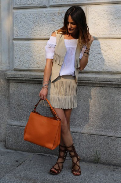 white from the blouse with crepe fringe vest and orange purse