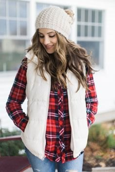 white knitted hat with red and black checkered shirt and light blue jeans
