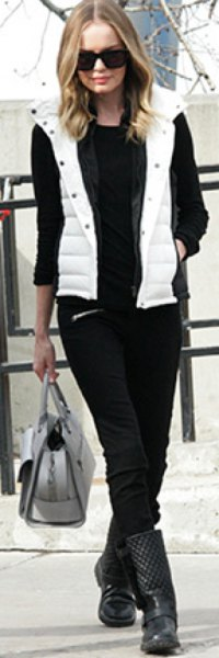 white hood down vest with black sweater and jeans