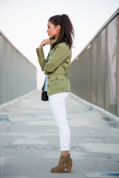 pink pink military jacket with white skinny slim jeans and camel boots