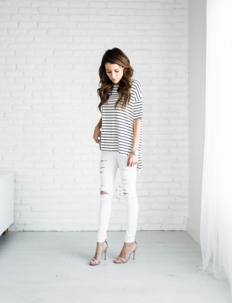 black and white striped t-shirt and ripped white jeans