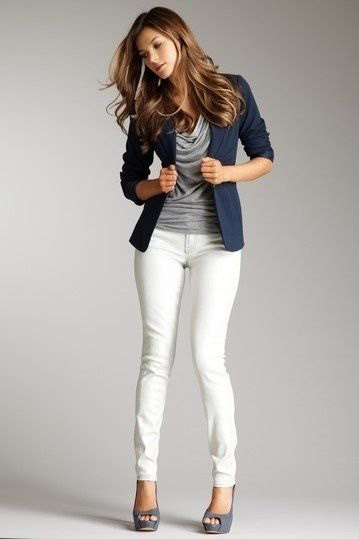 navy blazer with gray top on the neck and white skinny jeans