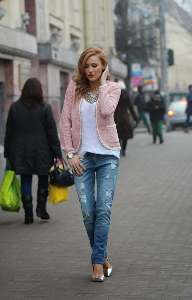 light gray jacket with white scoop neck top and ripped jeans