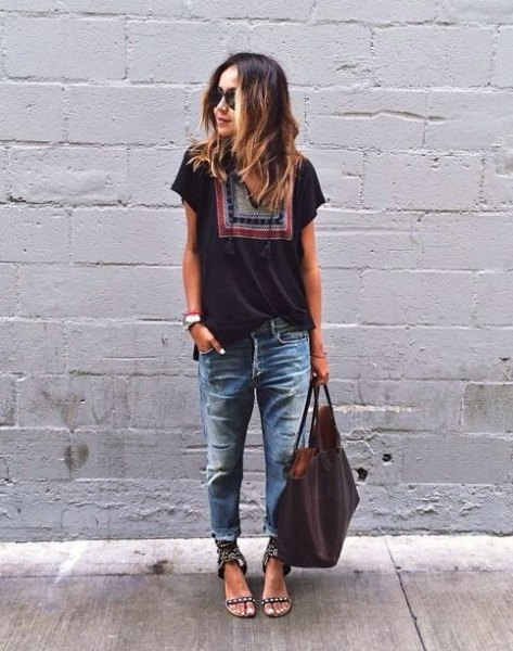 black tribal t-shirt with heavily ripped and washed boyfriend jeans