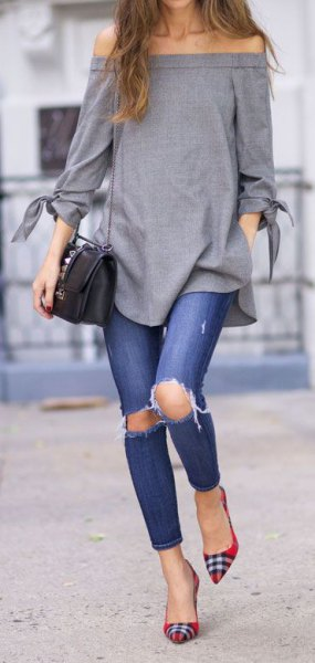 gray from the shoulder top with ripped jeans and red and black checkered flats
