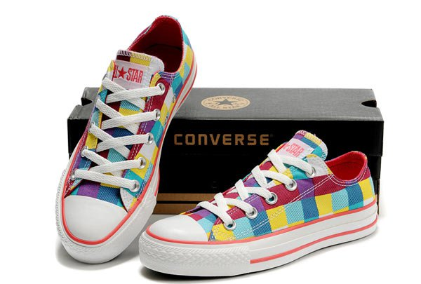 yellow-blue red and white low-canvas sneakers