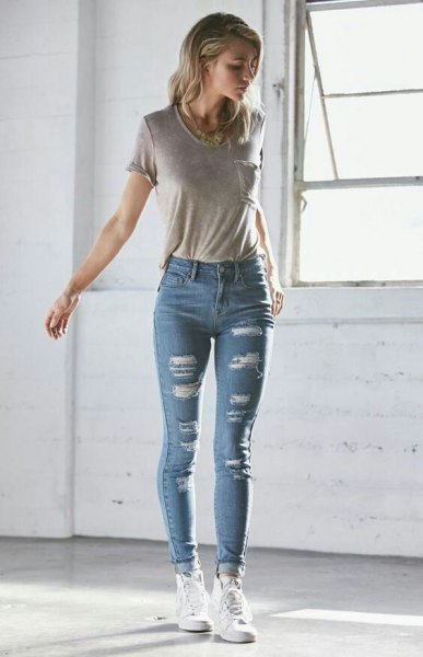 gray t-shirt with blue high skinny cuffed jeans