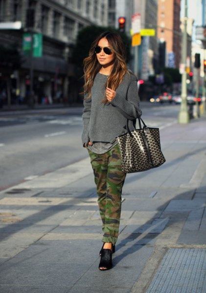 gray knitted sweater with camo straight leg jeans and black ballet flats