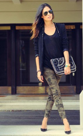 black shoe neck vest with blazer and cropped camo jeans
