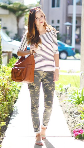 black and white striped halter tee with cuffed camo pants